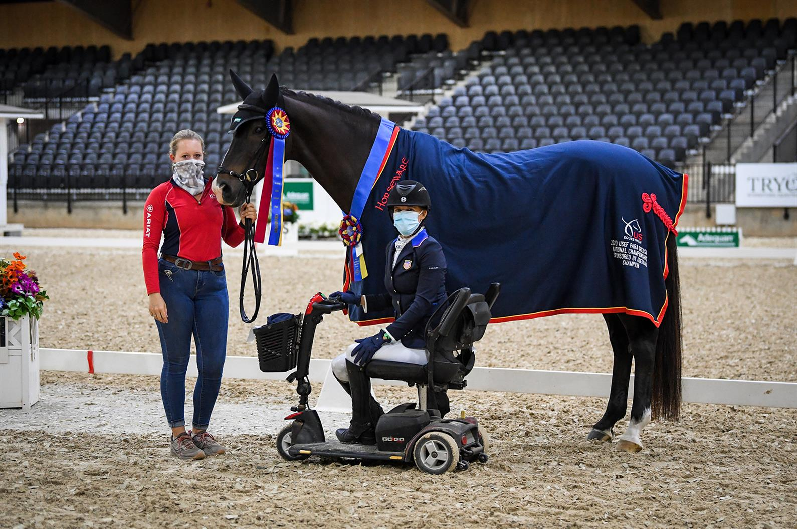 Rebecca Hart posing with El Corona Texel with the champion ribbons and cooler from the Adequan/USEF Para Dressage National Championship
