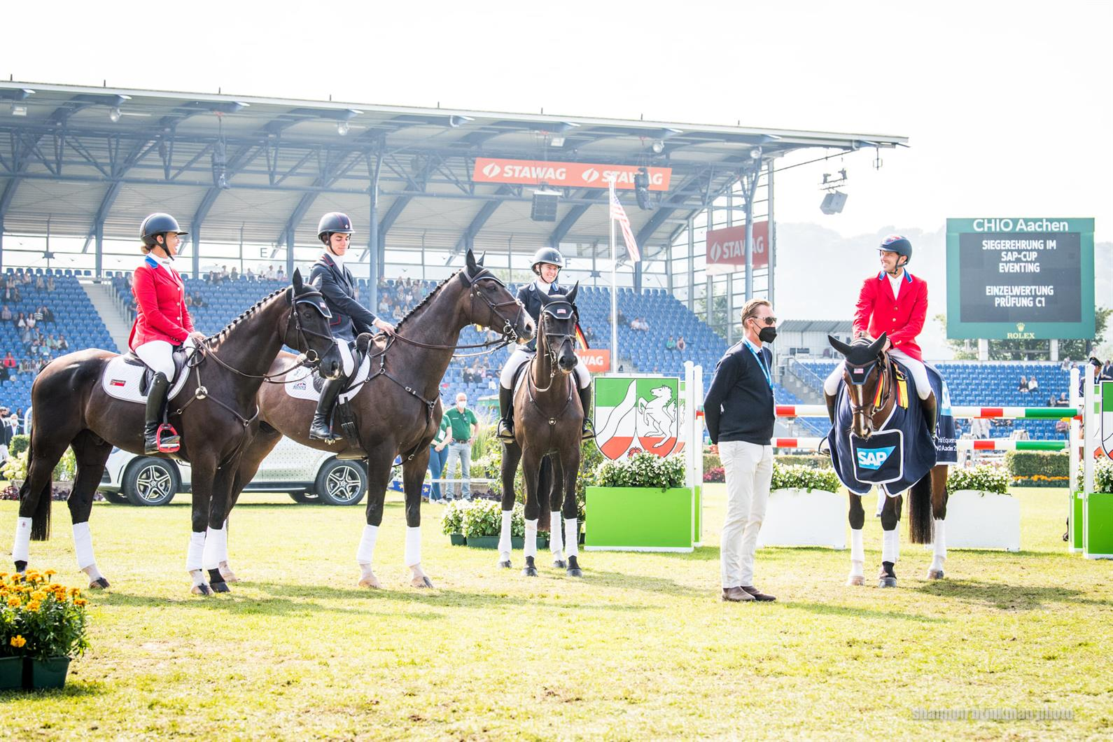 The members of the US Eventing team for the 2021 CHIO Aachen at the prize-giving in the stadium