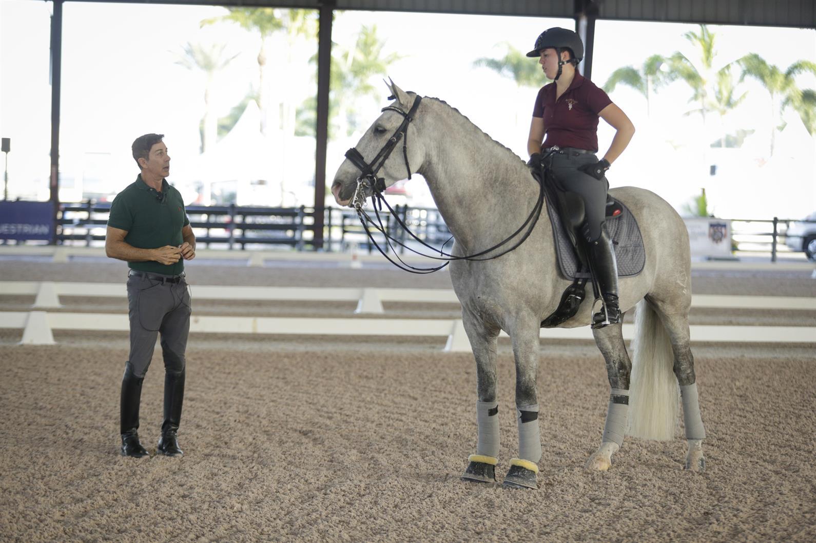 Robert Dover coaches Kerrigan Gluch during the Robert Dover Horsemastership Clinic Week in Wellington, Florida.