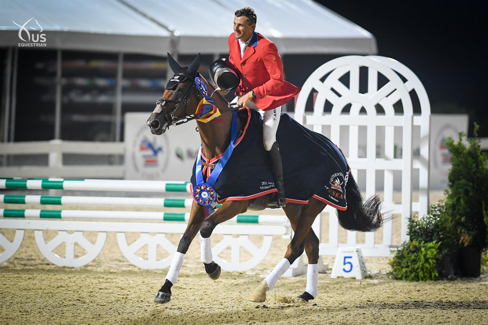 Boyd Martin and On Cue taking a victory lap at the 2021 USEF Advanced Horse Trials National Championship