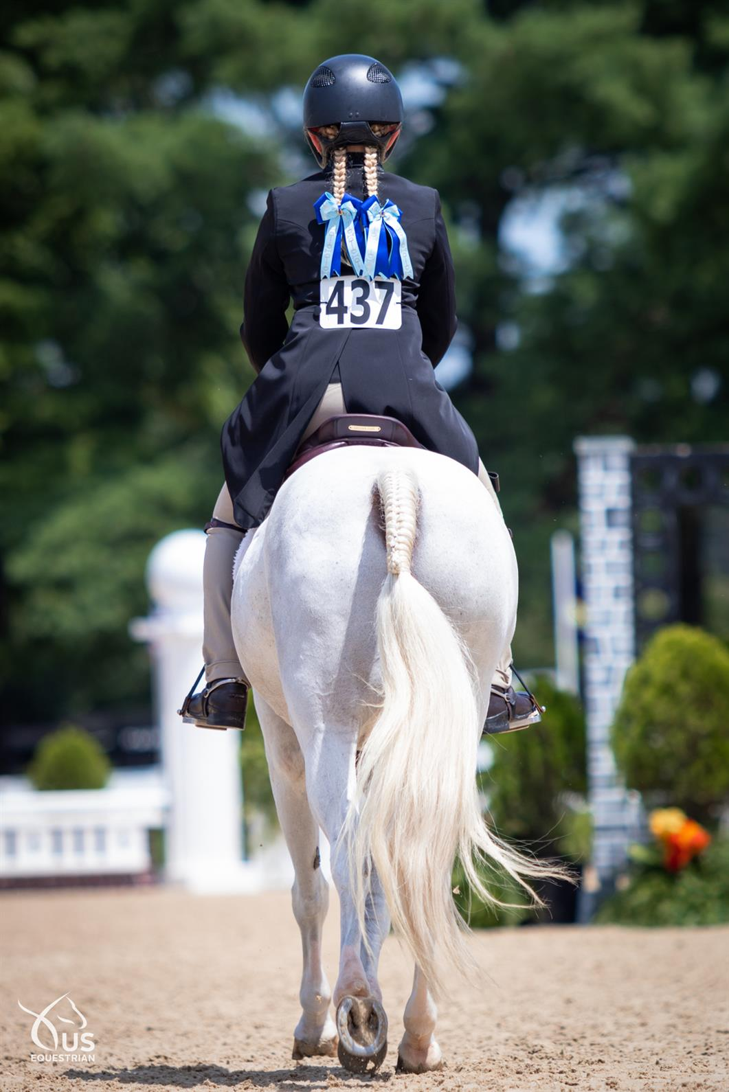Pony and rider walking away from the camera at USEF Pony Finals