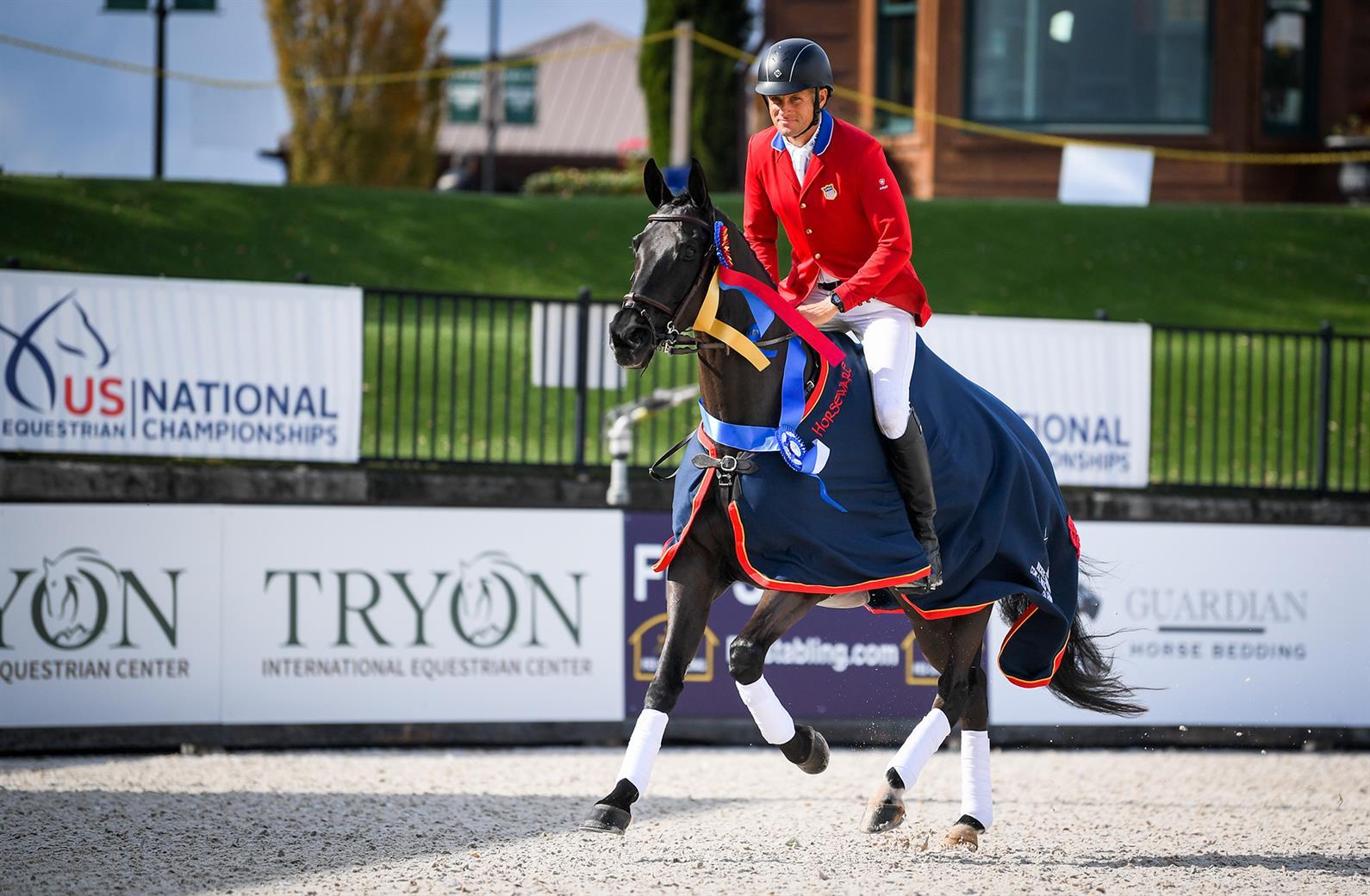 Boyd Martin and Tsetserleg taking a victory gallop